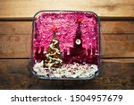 Stock photo home new year is herring salad under a coat with the decoration of the russian kremlin and a tree 1504957679