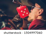 Feeling Lucky Casino Player Kissing Hanged in His Car Red Playing Dice. Gambling Theme. - stock photo