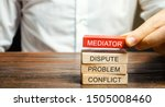 Small photo of A man holds wooden blocks with the word Mediator, dispute, problem, conflict. Settlement of disputes by mediator. Dispute Resolution and Mediation. Third party, intermediary.
