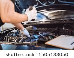 Small photo of Mechanic man examining and maintenance to customer the engine a vehicle car hood, Safety inspection test engine before customer drive on a long journey, transportation repair service center