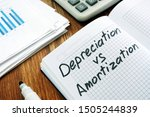 Small photo of Depreciation and amortization sign in a notebook.