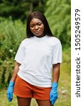 Small photo of African volunteer woman in park. Africa volunteering, charity, people and ecology concept.