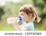 three year child drinking from... | Shutterstock . vector #150530384