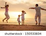 happy beautiful family dancing... | Shutterstock . vector #150533834