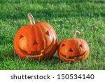 Two Pumpkin On Green Grass