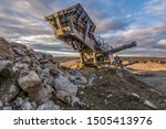 Small photo of Mechanical conveyor belt to pulverize rock and stone and generate gravel