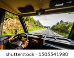 Woman is driving motorhome or campervan on the road outdoors in nature. Motorhome is following a campervan on adventure family trip or journey in nature in Galicia Spain. Exploring on active vacation - stock photo