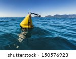 A Yellow Buoy In The Sea