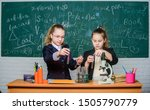Small photo of School project investigation. School experiment. Science concept. Gymnasium students with in depth study of natural sciences. Girls school uniform busy with proving their hypothesis. Private school.
