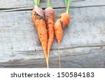three orange carrot on the wood ... | Shutterstock . vector #150584183