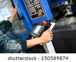 worker working with cnc machine ... | Shutterstock . vector #150589874