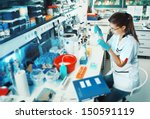 young scientist works in modern ... | Shutterstock . vector #150591119