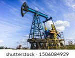 Small photo of Oil Drilling Rig, Extraction of Oil, Pump Jack and Oil Wellhead, Industry Equipment Close Up, Oilfield, Oil Derrick