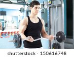 handsome man lifting heavy... | Shutterstock . vector #150616748