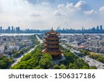 "The yellow crane tower , located on snake hill in Wuhan, is one of the three famous towers south of yangtze river,China.4 Chinese letters on tower is ""Nang Xiong Gao Gong"" means ""amazing heaven"""