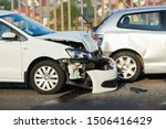 Small photo of car crash accident on street. damaged automobiles