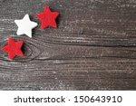 Three Stars On A Wooden...
