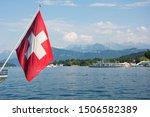 switzerland flag near lake ... | Shutterstock . vector #1506582389