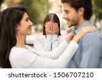 Small photo of New love. Woman crying, watching her ex boyfriend starts happy love relations, park background