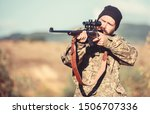 Small photo of Hunting permit. Man brutal gamekeeper nature background. Bearded hunter spend leisure hunting. Hunter hold rifle. Focus and concentration of experienced hunter. Hunting and trapping seasons.