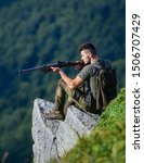 Small photo of Focused on target. Hunter hold rifle. Hunter spend leisure hunting. Man brutal gamekeeper nature landscape background. Hunting in mountains. Hunting masculine hobby concept. Regulation of hunting.