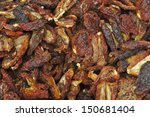Dried tomatoes at a market in Italy - stock photo