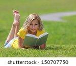 girl reading the book. blonde... | Shutterstock . vector #150707750