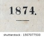 The year 1874 as printed on the title page of a yearbook published that year. The main subject, the figures, 1, 8, 7, 4, is in focus. The structure of the paper is visible. Some foxing