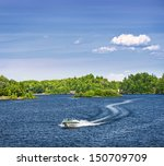 Woman Piloting Motorboat On...