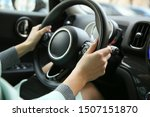 Driver\'s Hands On A Car...