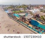 Small photo of 26.07.2019 Bali, Indonesia: FINNS Bali Beach Club Batu Balong beach, the world famous surf hot spot on Bali