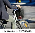 Close up of Suit on bike - stock photo