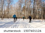 A Group Of People Skiing In A...