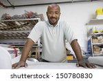 workman reading a blueprint | Shutterstock . vector #150780830
