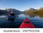 Adventurous Man Kayaking In...