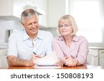retired couple signing documents | Shutterstock . vector #150808193