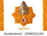 Stock photo happy navratri durga pooja marigold flower petals decoration maa durga face in metal 1508322143