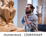 Man Visiting Sculpture Hall In...
