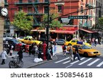 Small photo of NEW YORK CITY - OCT 17 2009:Traffic on Ninth Avenue and Columbus Avenue in New York,USA.Former president Bill Clinton initiated a project to revitalize the 9th Av corridor around Hell's Kitchen area
