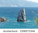 Parus rock - a low rock on the southern coast of Crimea, which is part of the Cape Limen-Burun. After the earthquake of 1927, the isthmus collapsed, and the rock separated from the shore.