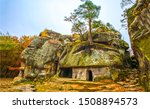 Small photo of Autumn mountain rock town view. Ancient rock town in autumn. Autumn rock town cave view. Rock town cave in autumn