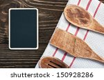 wooden kitchen utensils and a... | Shutterstock . vector #150928286