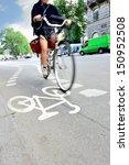 Motion blurred woman on bike - stock photo
