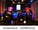 Three Microphones At Bar...