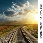 railroad goes to horizon in sunset - stock photo