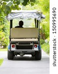 Back View Of Golf Cart In The...