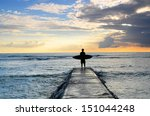 a surfer enjoys the view of the ... | Shutterstock . vector #151044248