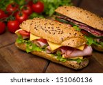 sandwiches on the wooden table | Shutterstock . vector #151060136