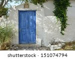 Old Greek House With Blue Door