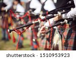 Small photo of Scottish bagpipe marching band close up on bagpipes